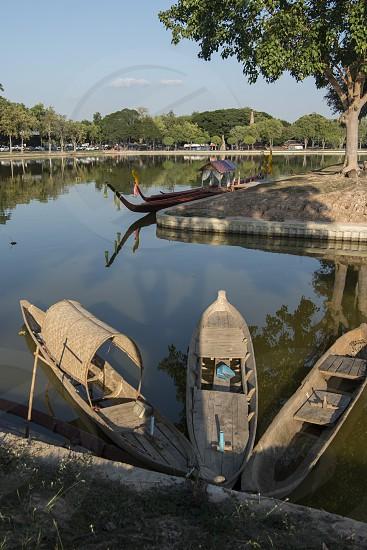 fishingboat at the lake at the Historical Park in Sukhothai in the Provinz Sukhothai in Thailand.   Thailand Sukhothai November 2018 photo