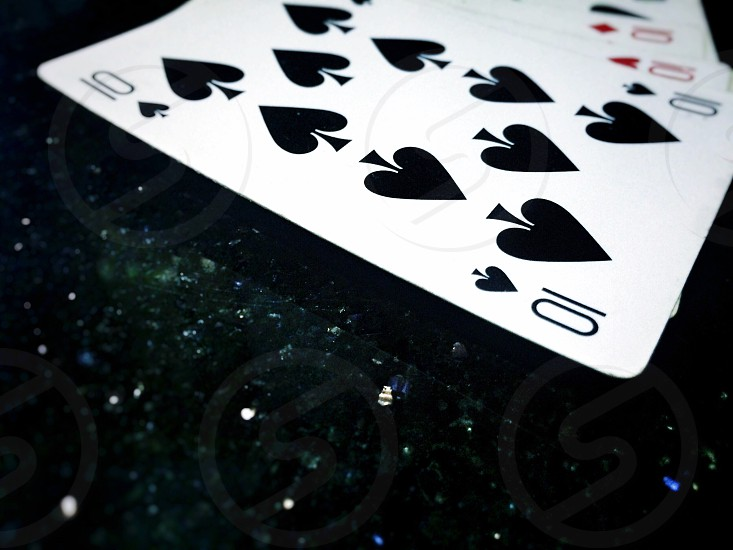 cards number 10 playing cards focus black background sparkling sparkle  photo