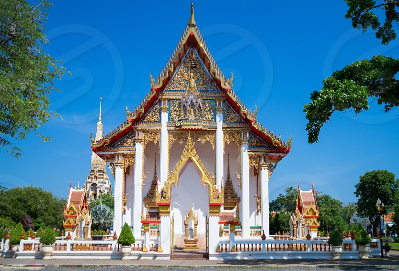 Beautiful Thai temple with traditional ancient art architecture with clear blue sky background - Phuket Thailand photo