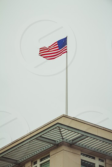 American flag on top of the US Embassy in Berlin on a winter day. photo