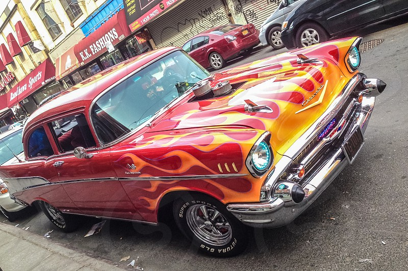 red and yellow flames paint job classic car photo