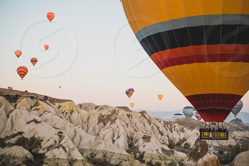 hot air balloons balloon hot air balloon travel explore adventure wanderlust alternative different from above air Turkey Cappadocia landscape transport transporting aerial view high photo