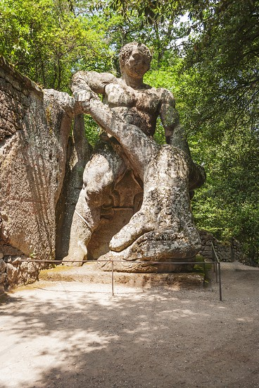 Bomarzo VT Italy july 2014: Ercole e Caco (Hercules and Caco) statue in the park of the monsters in Bomarzo Italy. It represents the struggle between the two giants Hercules and Caco. photo