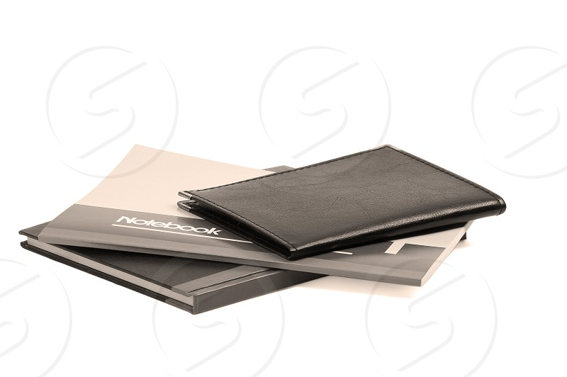 assorted notebooks flat piled on white backgroundsepia filter photo