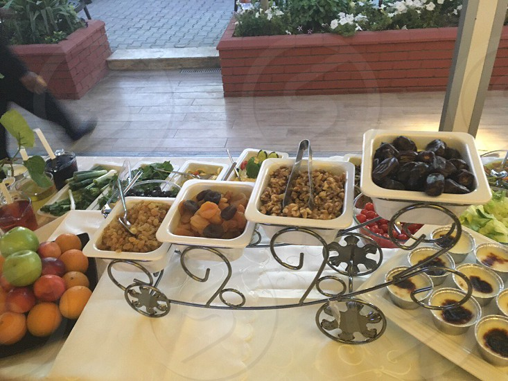 assorted dish and fruits on table photo