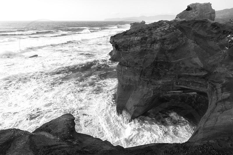 Ocean storm rocks b&w photo