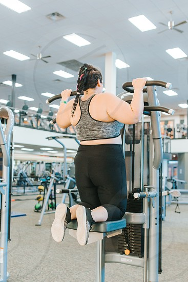 Woman working out at the gym photo
