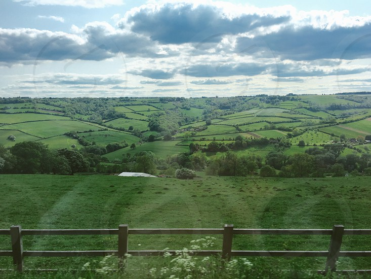 England view bus green crops hills plots travel study abroad hill farming farm greenery photo