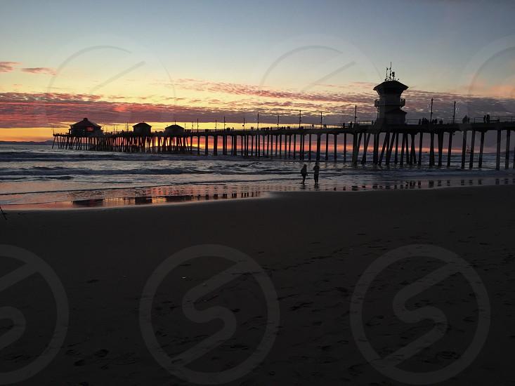 Beach pier Huntington California sunset  photo