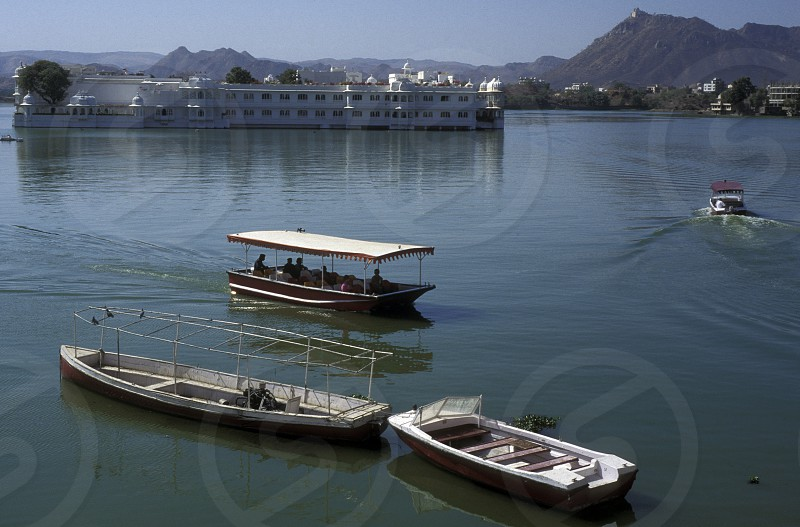 the Lake with the Palace in the town of  Udaipur in Rajasthan in India. photo