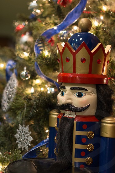 Nutcracker next to Christmas tree photo