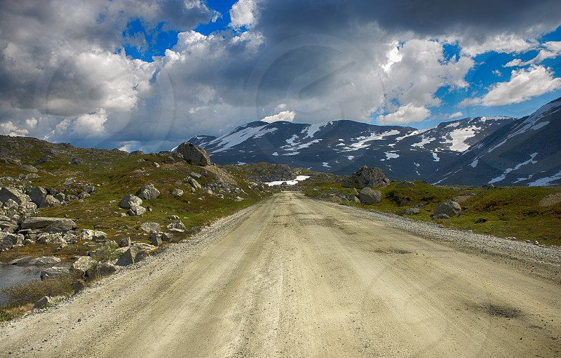 gamle strynefjellsvegen road one of the most beautifull auto roads in norway with snow in summer  photo