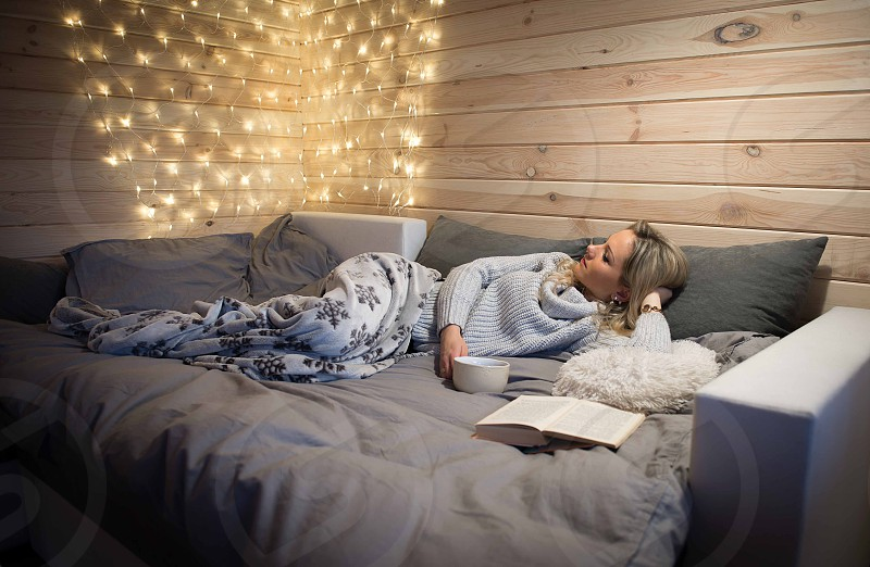 Woman read a book in cozy mountain cabin photo