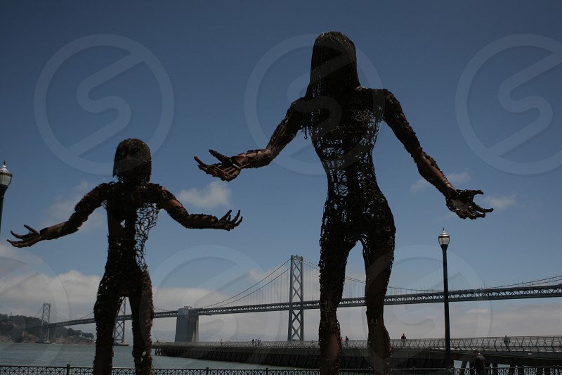 Statues in front of the San Francisco Bay Bridge San Francisco CA photo