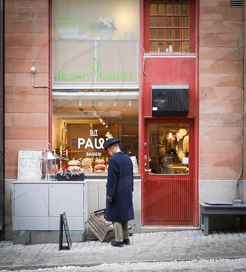 Storefrontstore front  bakery display man street door city photo