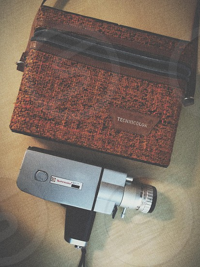 gray camera and orange sling bag photo