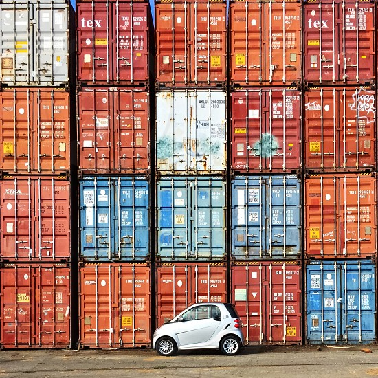 All Electric SmartCar in front of shipping containers  photo