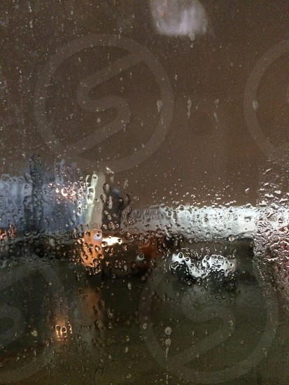 water droplets on glass window photo
