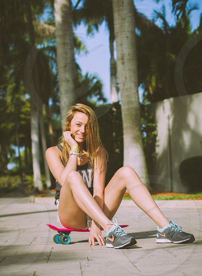 woman sitting on skateboard photography photo