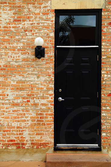 door black light entry brick red photo