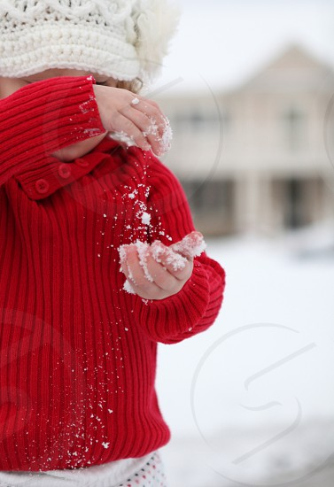 Little girl playing with snow photo