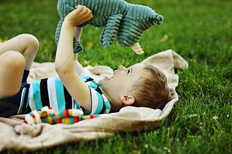 baby boy playing with zebra plush photo