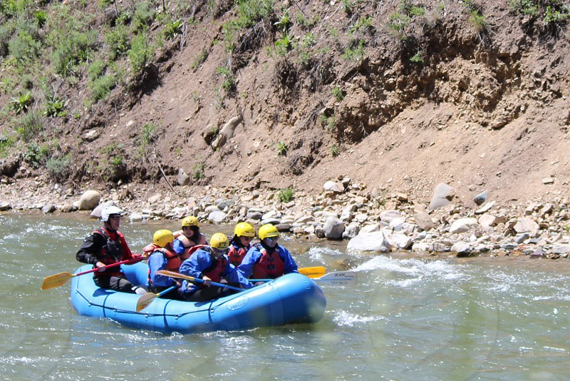 view of people river rafting photo
