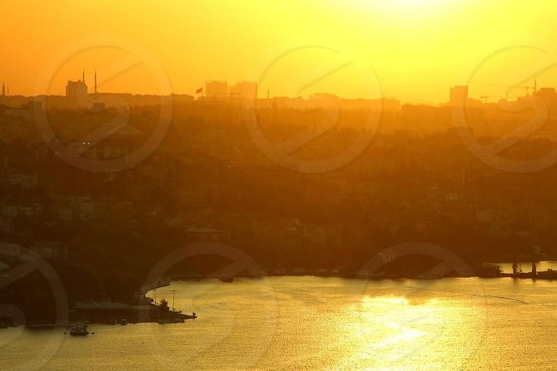 sunrise bosphoruus sun cityscape city istanbul turkey  photo