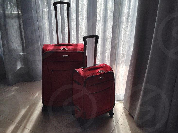 two red trolley bags photo