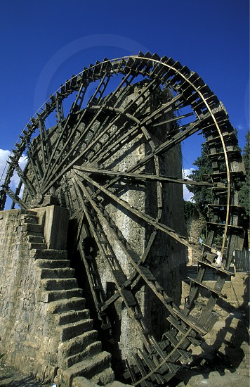 a traditional norias wooden water wheelsl in the city of Hama in Syria in the middle east photo