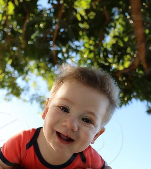 Boy under tree child portrait photo