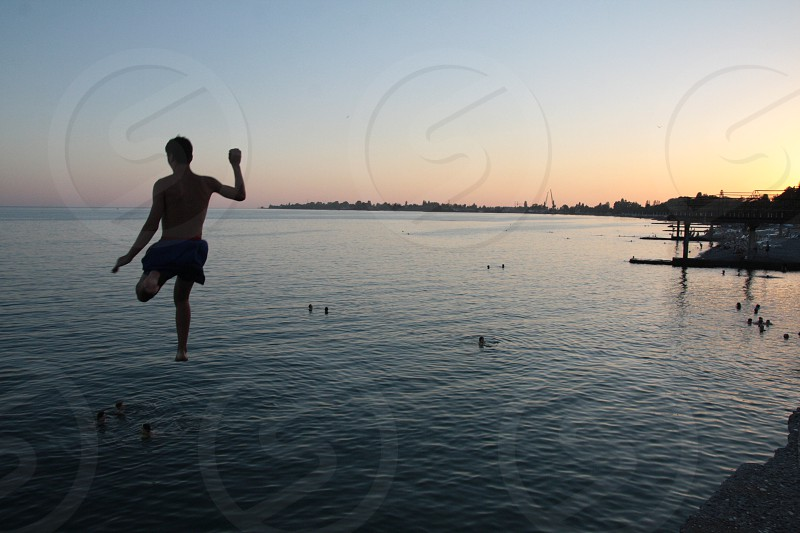 jumping into the sea photo