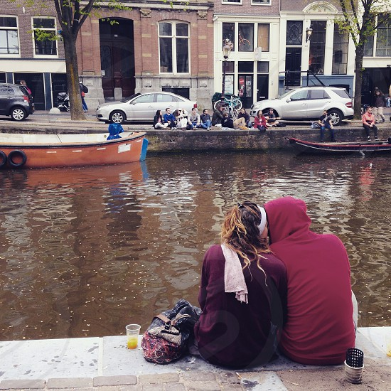 Love kiss couple romantic romance Amsterdam canal couple kissing at the canal lovers boy and girl kissinggirl and boy kissing in love date passion street outdoor two Netherlands photo