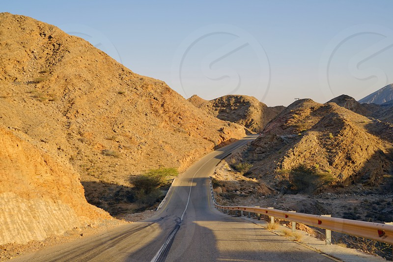 Driving on a desert road in the Sultanate of Oman outside of Muscat photo
