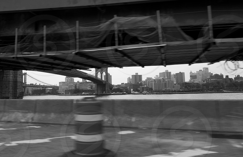 new york bridge framed in black and white photo