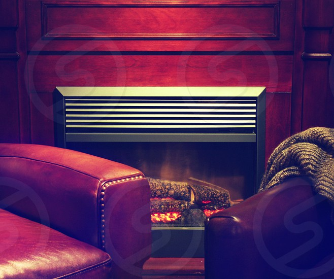 fireplace log fire chair leather warm cozy comfort mantle photo