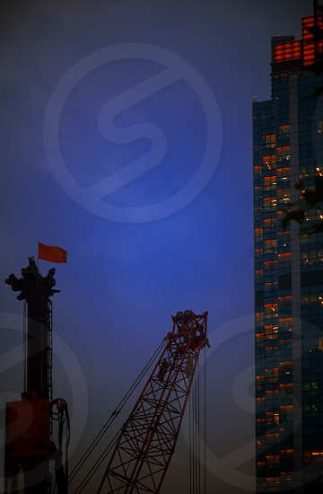 construction cranes on night ove a blue sky photo