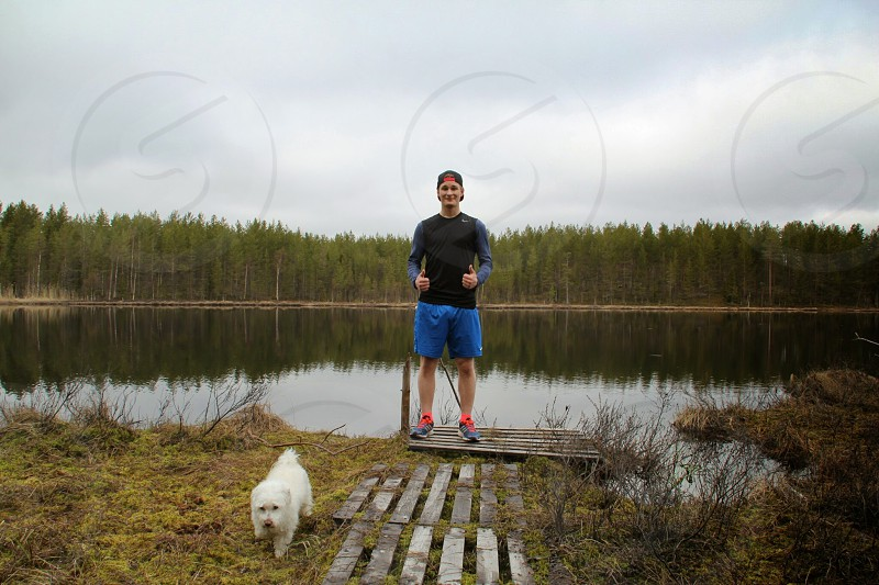 Dog and a man out walking end of the road nature walk activity joy life friend happiness health outdoor nature water lake outdoor Sweden photo