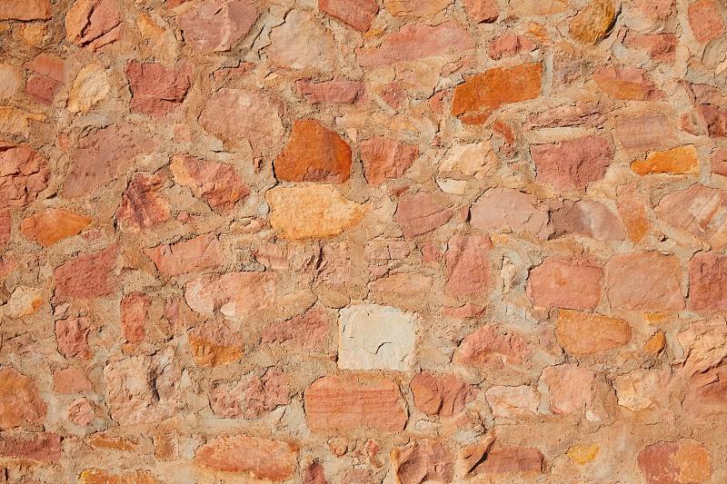 Masonry wall detail of rodeno limestone stone brickwall photo