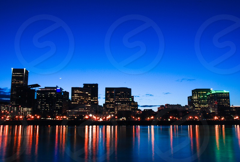 The Portland Oregon evening skyline reflecting in the Willamette River. photo