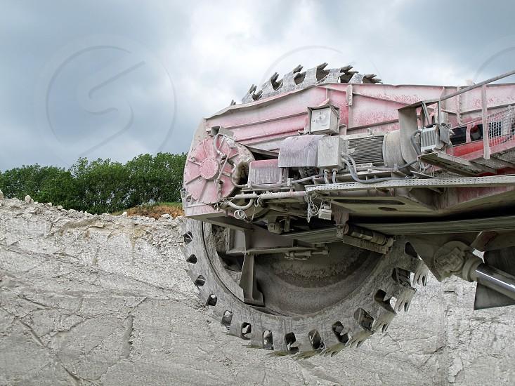 detail of a Bucket-wheel excavator in a chalk open pit mine photo