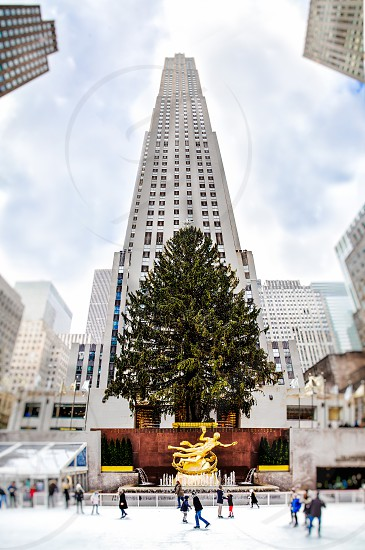 Rockefeller Center Christmas Tree and ice rink with 30 Rock towering above. photo