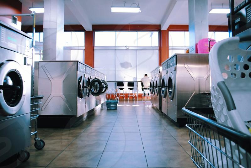 white plastic laundry basket in laundry mat photo