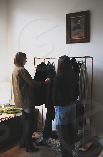 woman standing in front of clothes rack photo
