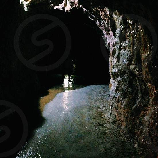 watery cave with white light passing through photo