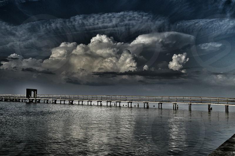 Door gate open welcome pier fishing water look out clouds sky horizon photo