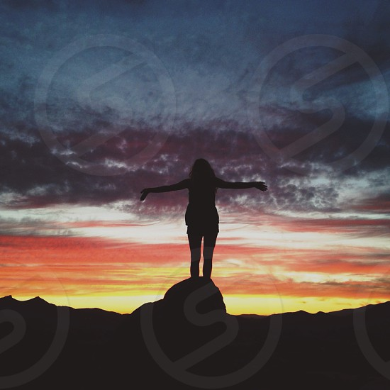 woman's silhouette and sunset photo