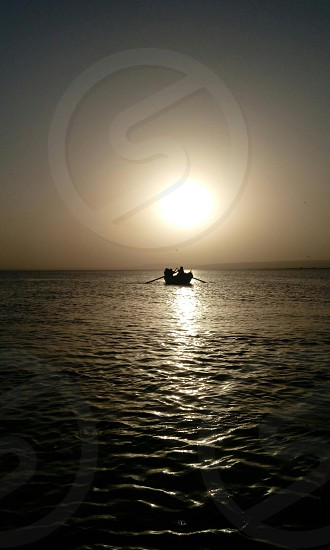 a boat at the sunset photo