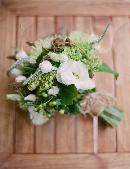 Floral arrangement gorgeousbouquetflowers wedding white green winter wood string rustic photo