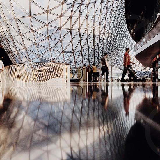 man walking inside modern structure photo